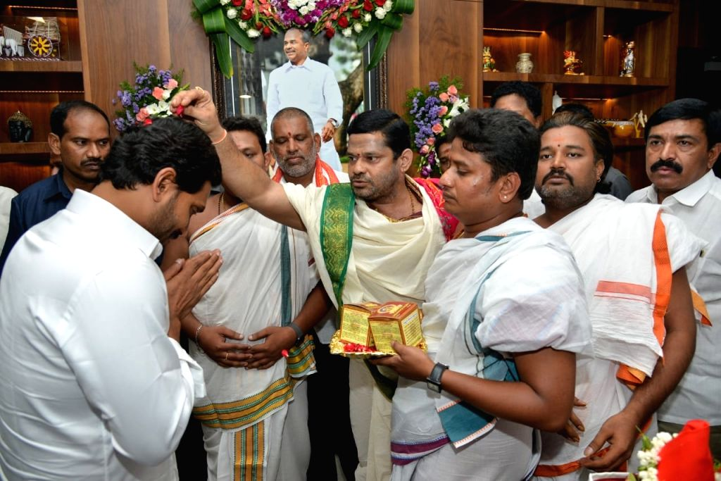 Andhra Pradesh Chief Minister Y.S. Jagan Mohan Reddy takes the blessings of priests ahead of the first session of new State Assembly, in Amaravati on June 12, 2019. - Y.
