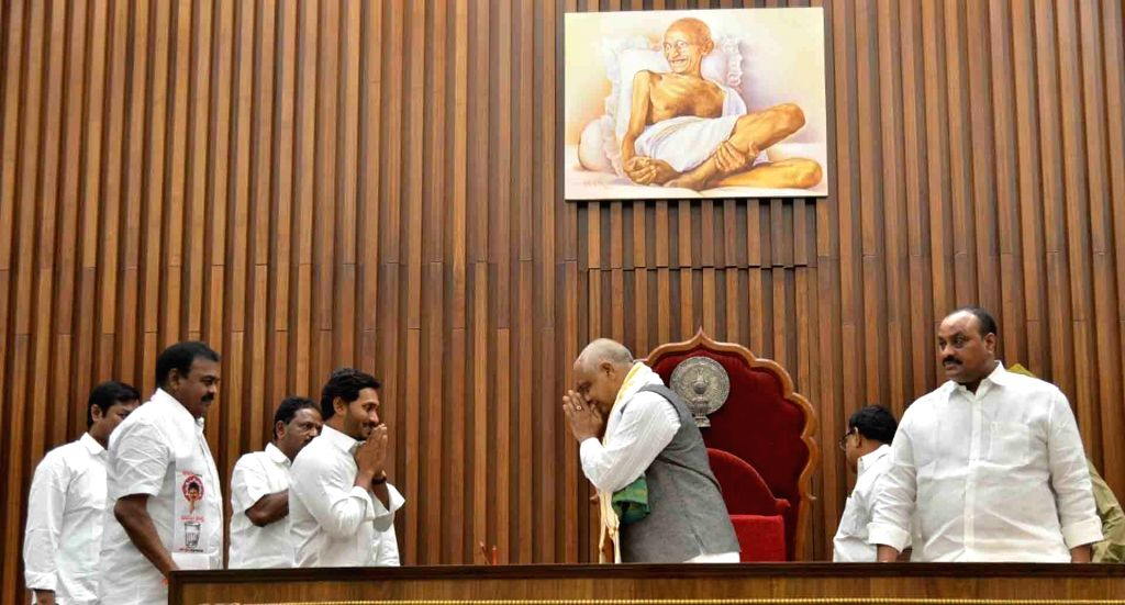 Andhra Pradesh Chief Minister Y.S. Jagan Mohan Reddy greets the newly elected Andhra Pradesh Legislative Assembly Speaker Thammineni Seetharam on the second day of the first session of the ... - Y.