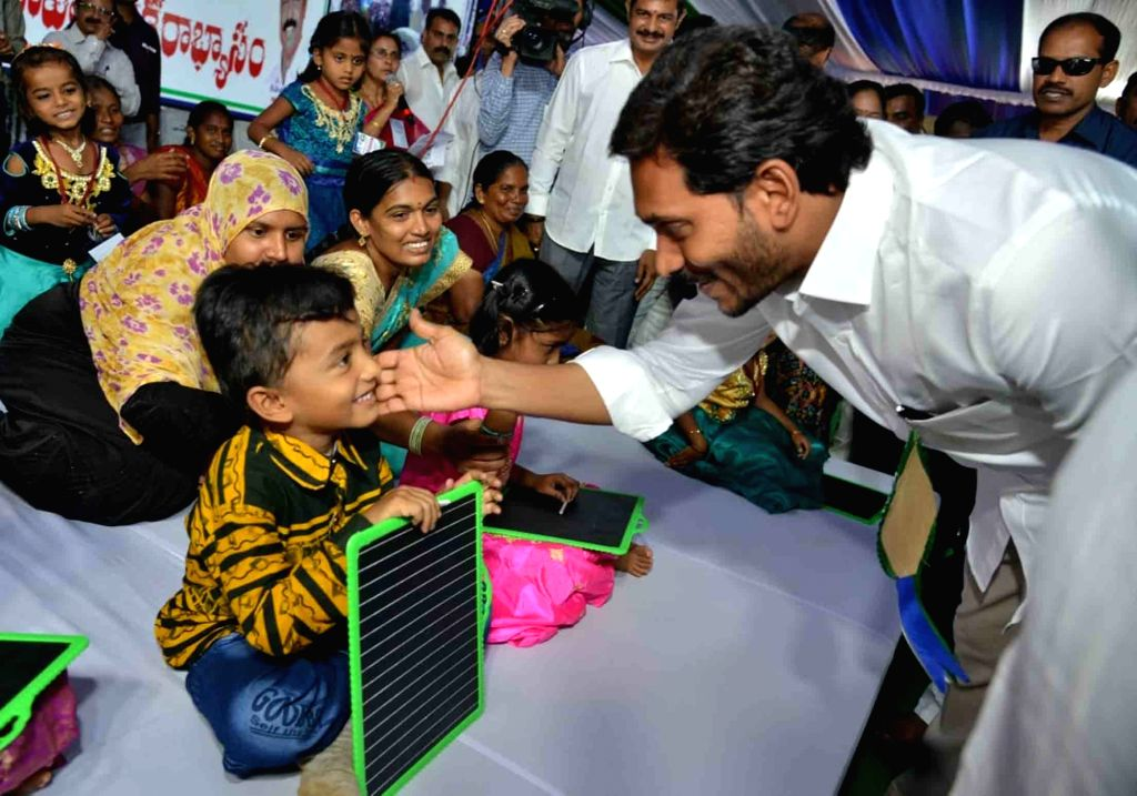 Andhra Pradesh Chief Minister Y.S. Jagan Mohan Reddy interacts with children during a programme in Vijayawada, on June 14, 2019. - Y.