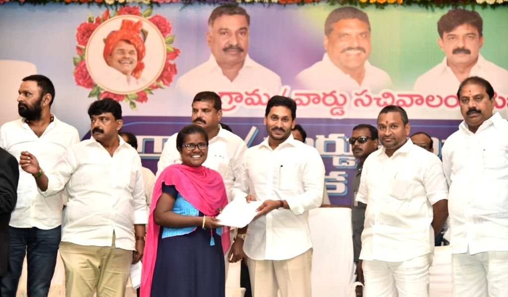 Andhra Pradesh Chief Minister Y.S. Jagan Mohan Reddy hands over the appointment orders to the selected candidates for the posts in village and ward secretariats, during a programme in ... - Y.