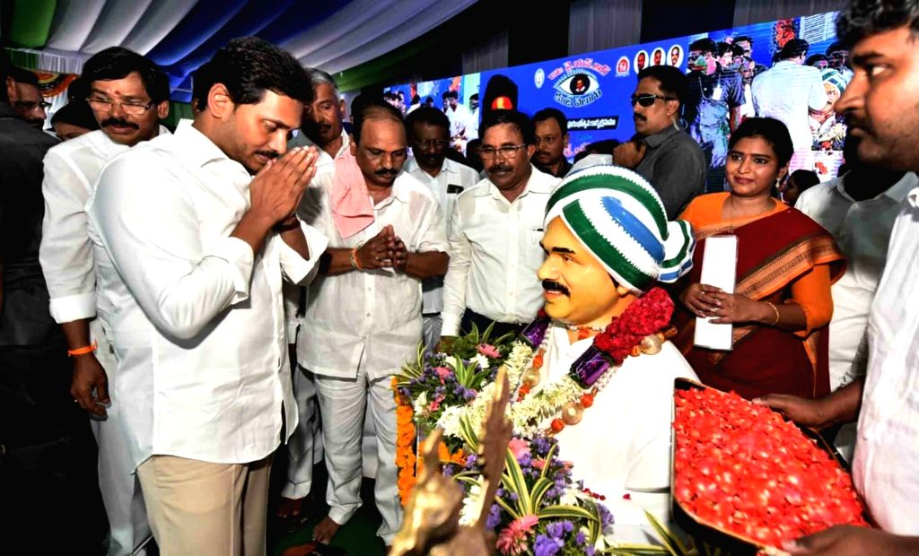Andhra Pradesh Chief Minister Y.S. Jagan Mohan Reddy pays tributes to his father Y. S. Rajasekhara Reddy at the launch of  'YSR Kanti Velugu' - an eye care scheme - on World Sight Day, in ... - Y.
