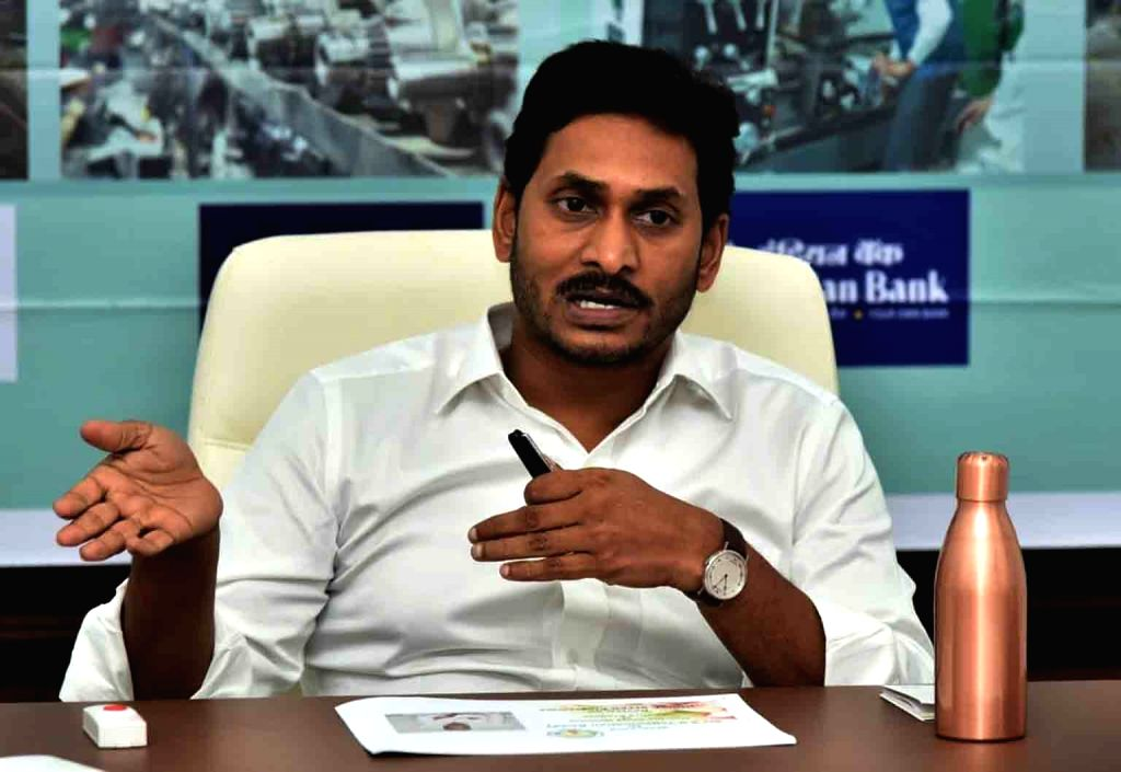 Andhra Pradesh Chief Minister Y. S. Jagan Mohan Reddy presides over a meeting to review the distribution of houses in the state, in Vijayawada on Oct 17, 2019. - Y. S. Jagan Mohan Reddy