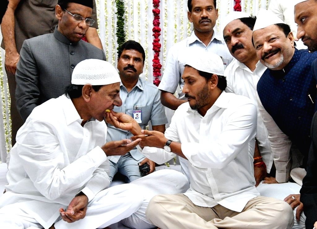 Andhra Pradesh Chief Minister Y S Jaganmohan Reddy with Telangana Chief Minister K Chandrasekhar Rao during an Iftaar party thrown by Andhra Pradesh and Telangana Governor ESL Narasimhan ... - Y S Jaganmohan Reddy and K Chandrasekhar Rao