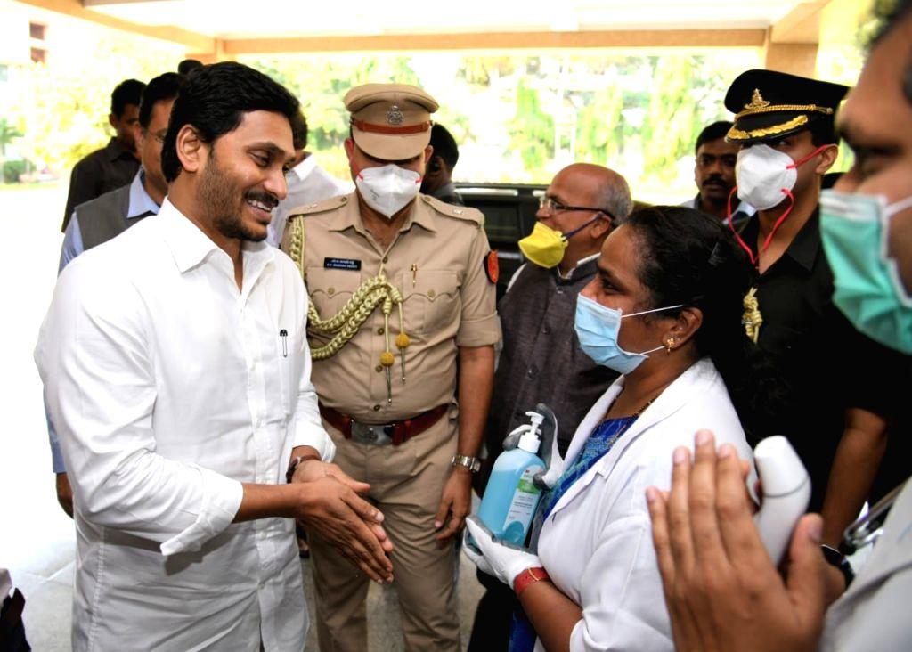 Andhra Pradesh Chief Minister YS Jagan Mohan Reddy sanitises his hands as he arrives at the Raj Bhavan to meet Governor Biswabhusan Harichandan on the sixth day of the nationwide lockdown ... - Jagan Mohan Reddy