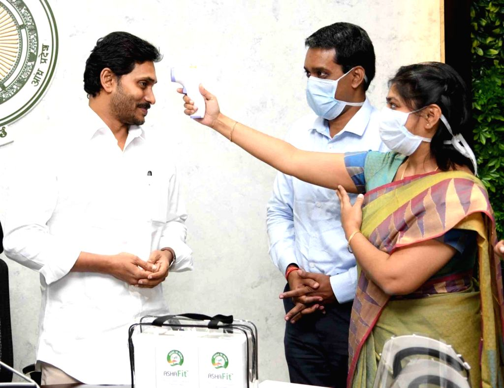 Andhra Pradesh Chief Minister YS Jagan Mohan Reddy being screened for COVID-19 at the launch of infrared non-contact forehead thermometer and proactive face masks in Vijayawada during the ... - Jagan Mohan Reddy