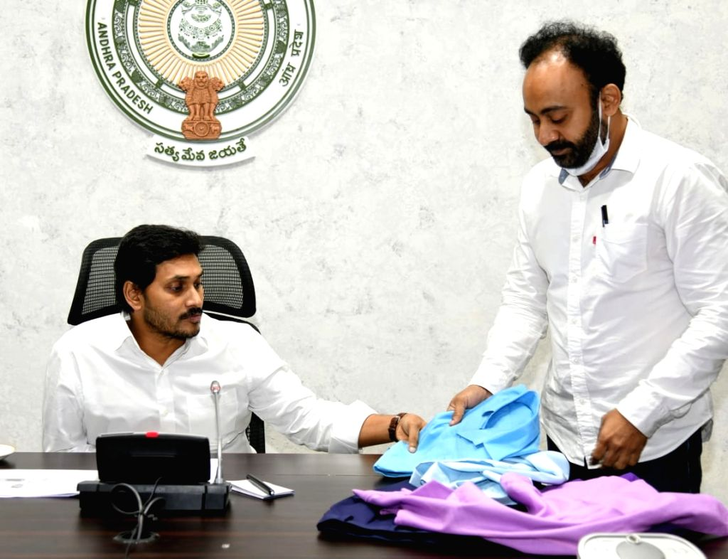 Andhra Pradesh Chief Minister YS Jagan Mohan Reddy chairs a meeting to review preventive measures against COVID-19 in Vijayawada during the extended nationwide lockdown imposed to ... - Jagan Mohan Reddy