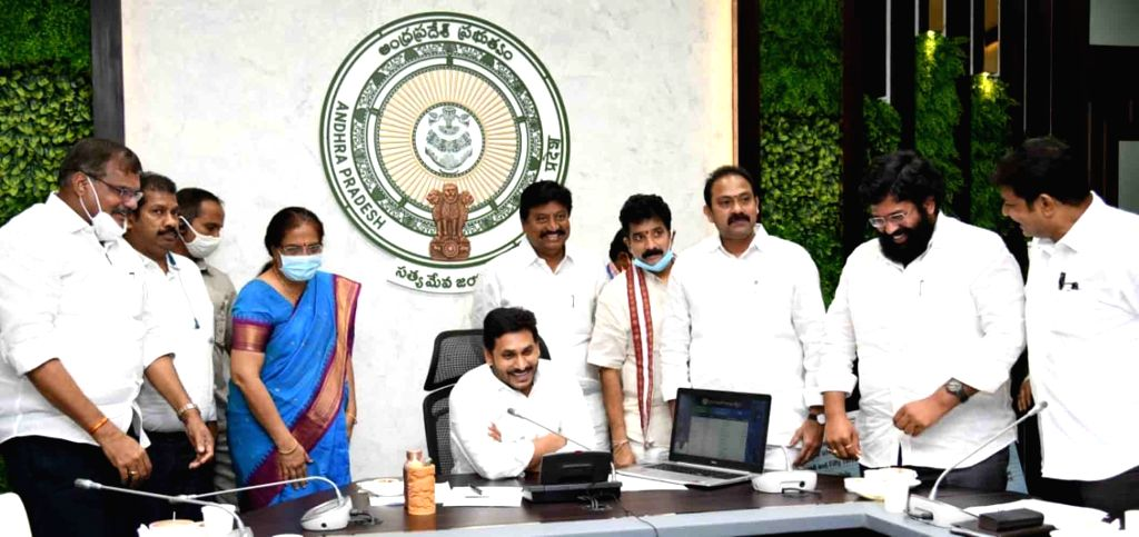 Andhra Pradesh Chief Minister YS Jagan Mohan Reddy at the launch of 'YSR Kapu Nestham' scheme for the welfare of the women from Kapu community, at his camp office in Tadepalli on June 24, ... - Jagan Mohan Reddy