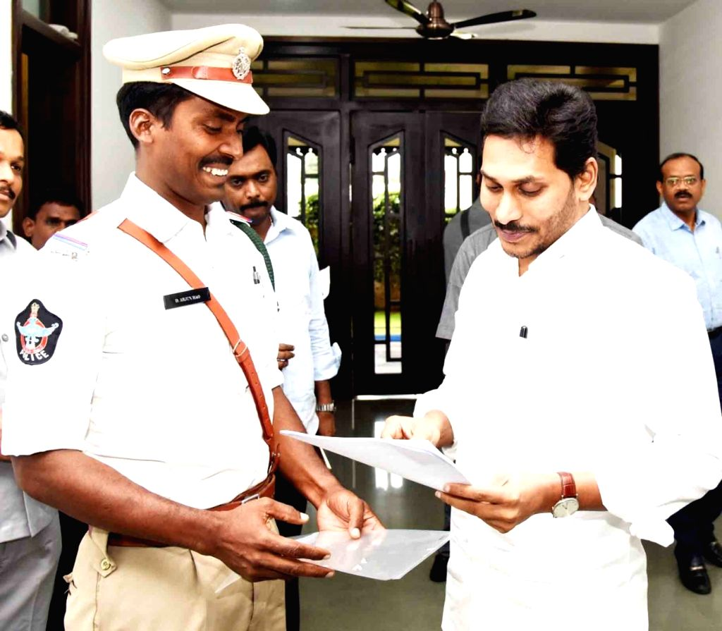 Andhra pradesh Chief Minister YS Jagan Mohan Reddy congratulates Reserve Sub Inspector Arjuna Rao, who rescued a woman who attempted to commit suicide at Vijayawada Bandar Canal, on Dec ... - Jagan Mohan Reddy