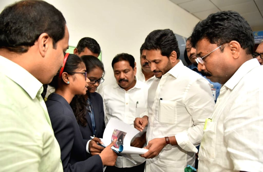 Andhra Pradesh Chief Minister YS Jagan Mohan Reddy felicitates a group of students who developed a multipurpose agricultural robot, in Vijayawada on Dec 11, 2019. - Jagan Mohan Reddy