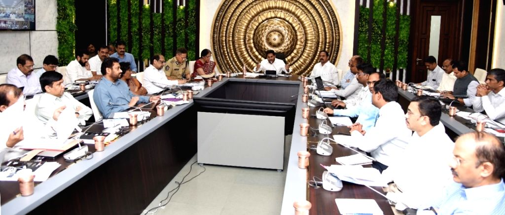 Andhra Pradesh Chief Minister YS Jagan Mohan Reddy chairs a meeting with district collectors and SPs on COVID-19 prevention measures amid coronavirus pandemic, via video conferencing in ... - Jagan Mohan Reddy