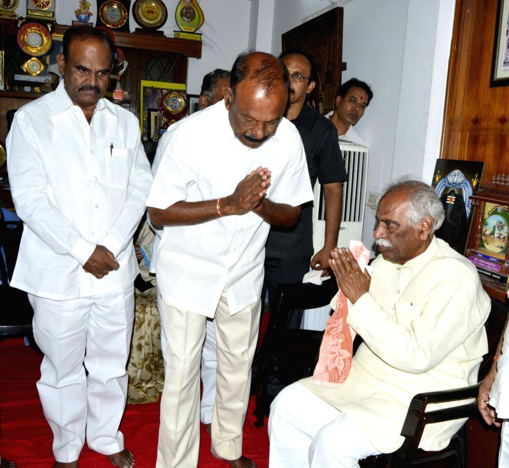 Andhra Pradesh Congress chief Raghu Veera Reddy meets Union Minister and BJP leader Bandaru Dattatreya after his son Bandaru Vaishnav, 21, died of a massive heart attack in Hyderabad on ... - Raghu Veera Reddy