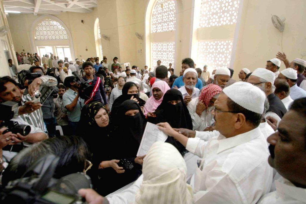 Andhra Pradesh Minority Welfare Minister Syed Mohammed Ahmadullah distributing Haj forms to pilgrims at AP Haj committee headquarter in Hyderabad on Feb 6.