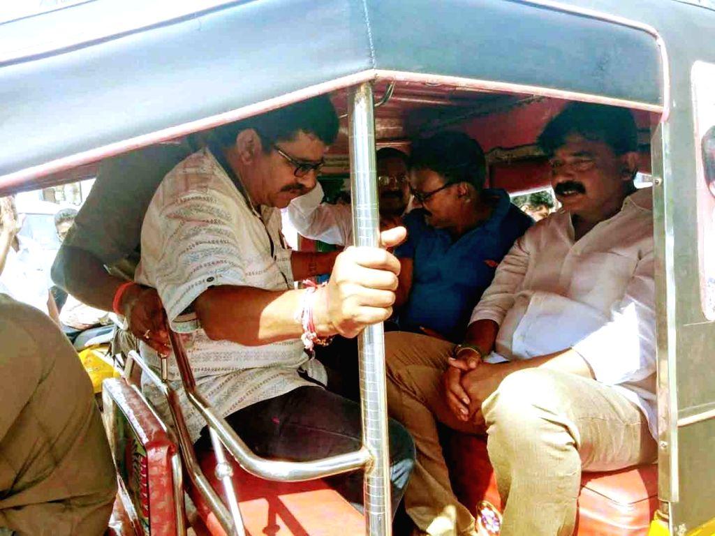 Andhra Pradesh Transport Minister Transport Minister Perni Venkataramaiah travels in an auto rickshaw as he takes stock of various development activities, in Machilipatnam on Oct 9, ... - Transport Minister Perni Venkataramaia