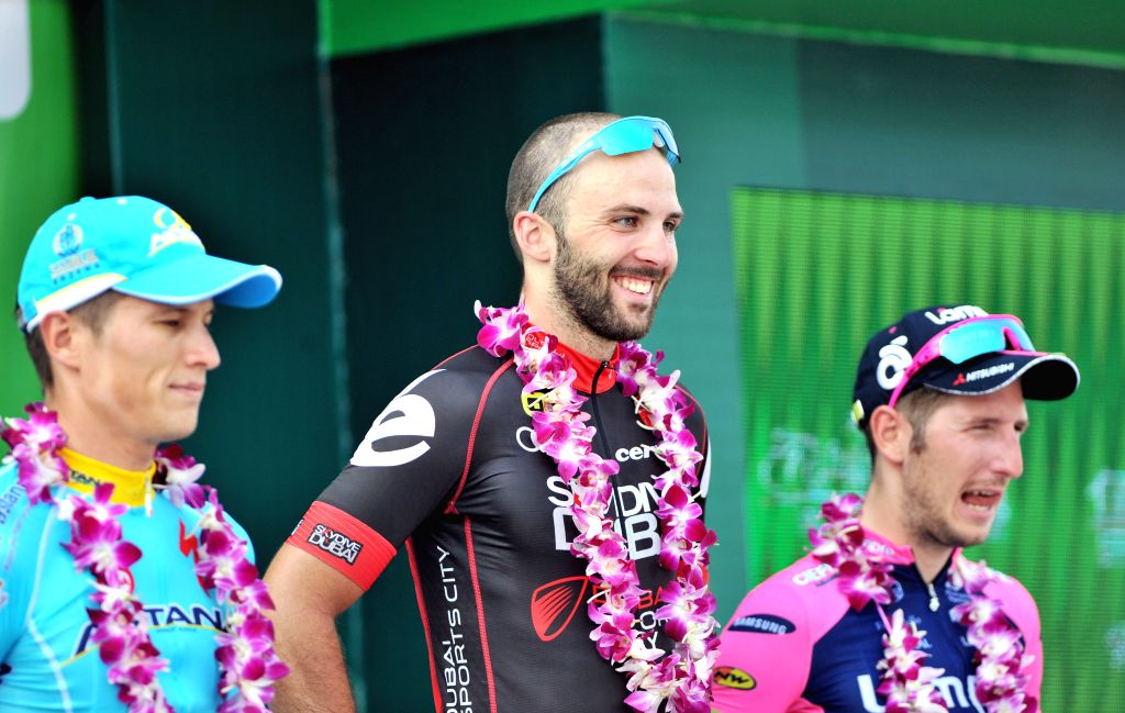 Andrea Palini (C) smiles during the awarding ceremony after the 2nd stage of the 2015 Tour of Hainan International Road Cycling Race in Wenchang, south China's ...