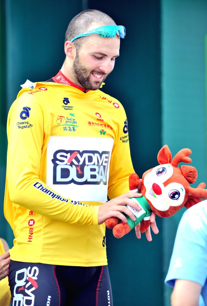 Andrea Palini wears the yellow jersey during the awarding ceremony after the 2nd stage of the 2015 Tour of Hainan International Road Cycling Race in Wenchang, ...