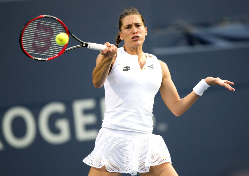 Andrea Petkovic of Germany returns the ball against Serena Williams of the United States during their third round women's singles match at the 2015 Rogers Cup in ...