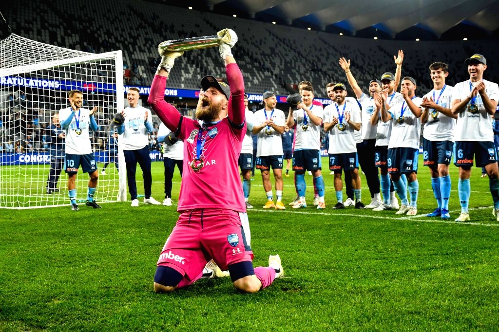 Andrew Redmayne (Front), goalkeeper of Sydney FC celebrates during the awarding ceremony for the 2019/2020 season A-League in Sydney, Australia, Aug. 30, 2020. ...