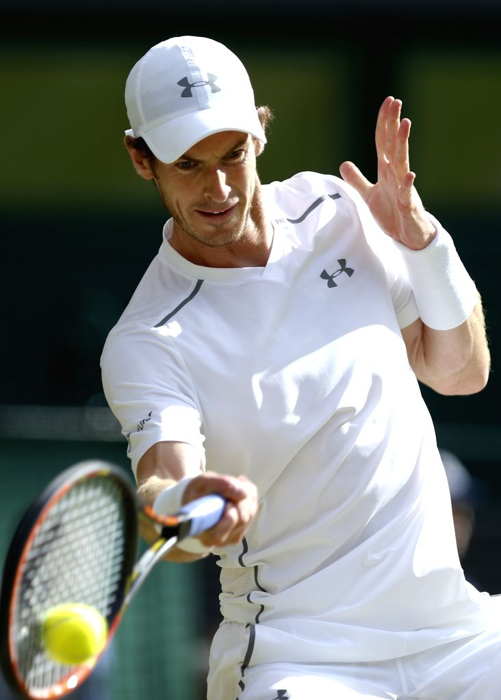 Andy Murray of Britain competes during the men's singles semifinal against Roger Federer of Switzerland at the 2015 Wimbledon Championships in Wimbledon, southwest ...