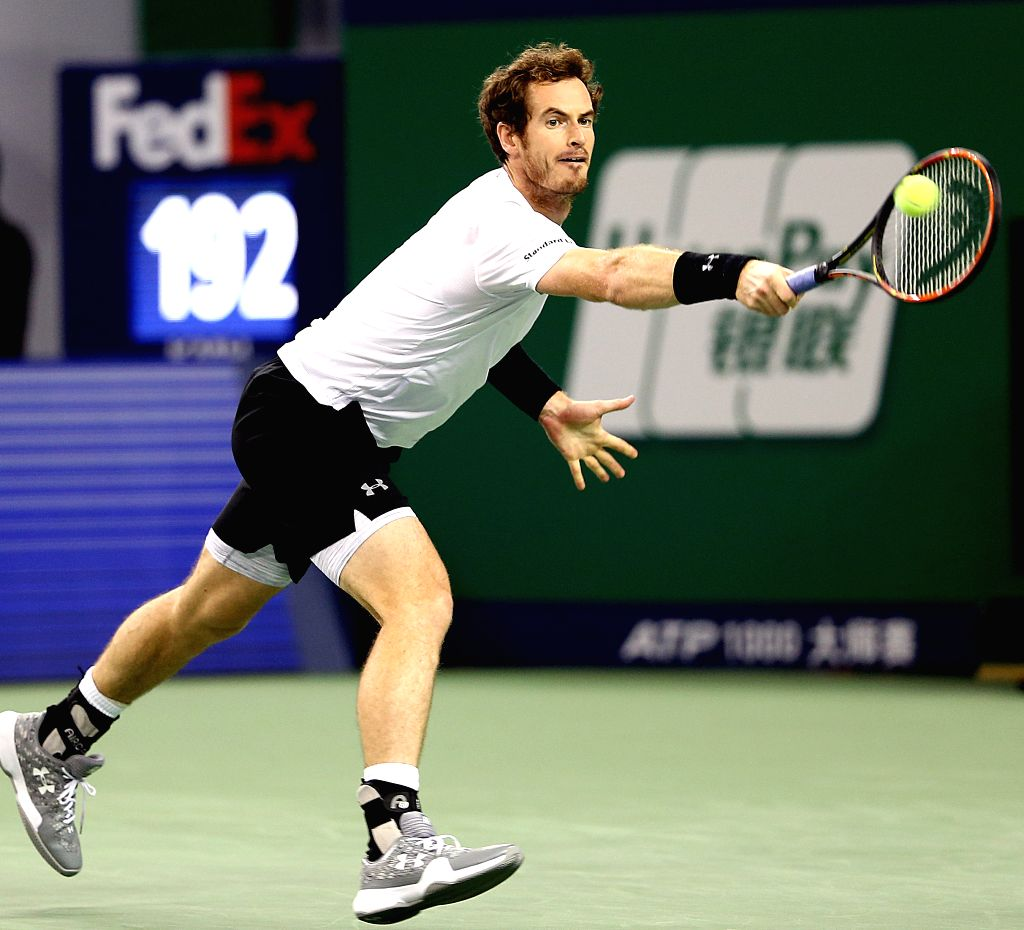 Andy Murray of Britain hits a return during his men's singles semi-final match against Novak Djokovic of Serbia at the Shanghai Masters tennis tournament in ...