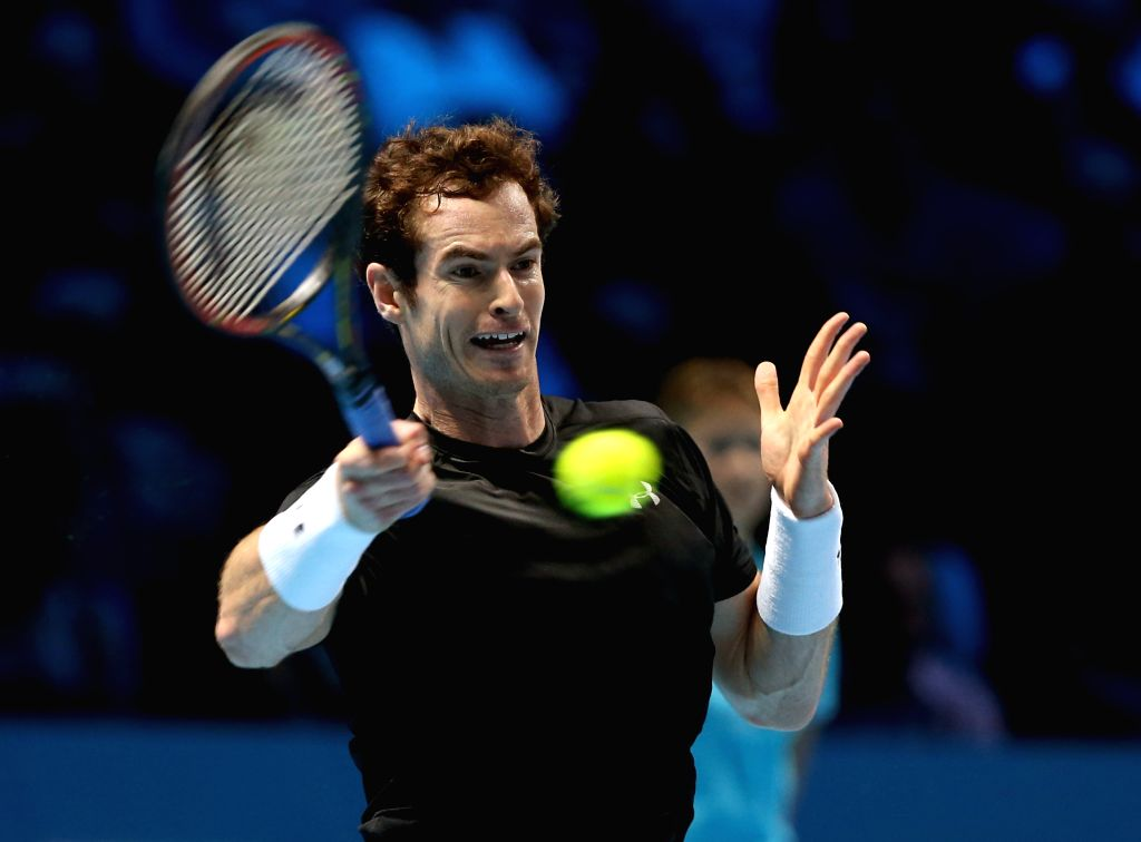 Andy Murray of Britain hits a return to Rafael Nadal of Spain during a men's singles group stage match at the ATP World Tour Finals in London, Britain, Nov. 18, ...