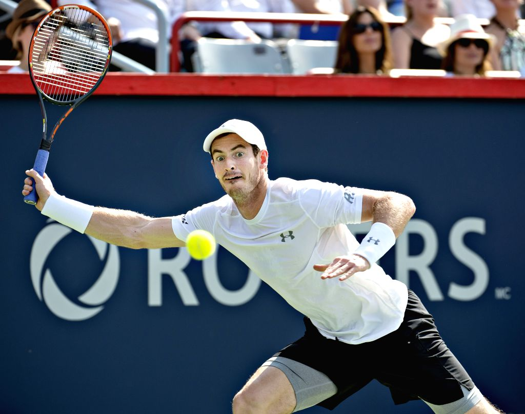 Andy Murray of Britain returns the ball to Novak Djokovic of Serbia in the men's singles final of the Rogers Cup tennis tournament at the Uniprix Stadium in ...