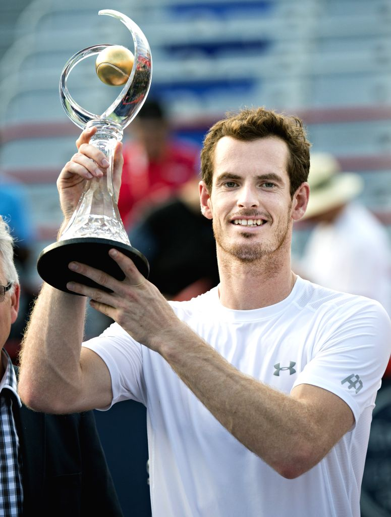 Andy Murray of Britain shows the trophy during the awarding ceremony for the men's singles event of the Rogers Cup tennis tournament at the Uniprix Stadium in ...
