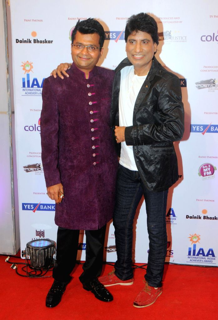 Aneel Murarka with Raju Srivastav during the International Indian Achiever`s Award 2014 presented by YES BANK in Mumbai on July 27, 2014.