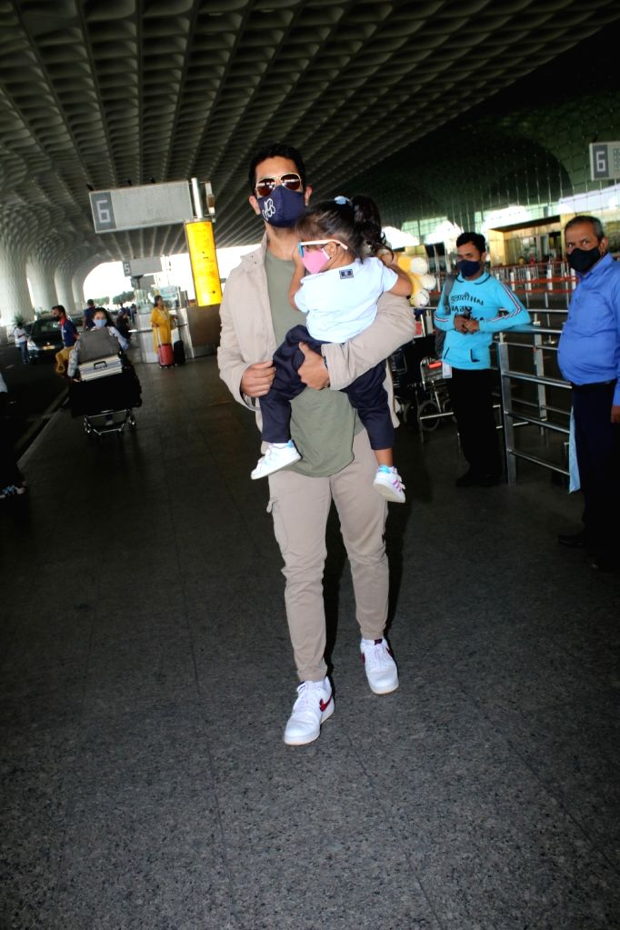 Angad bedi and his daughter spotted at airport departure On Saturday 27 March, 2021.