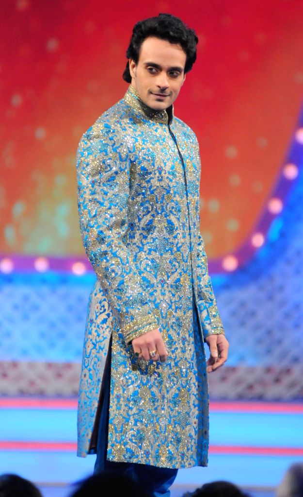 Angad Hasija wlks on the ramp during the International Indian Achiever`s Award 2014 presented by YES BANK in Mumbai on July 27, 2014.