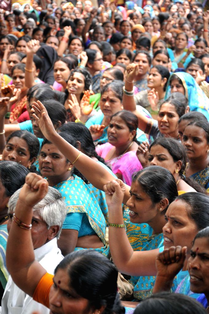Anganwadi teachers demonstrate at Telangana Secretariat to press for their various demands in Hyderabad on July 7, 2014.