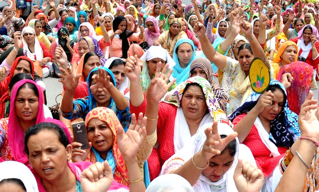 Anganwadi workers stage a demonstration against the Central Government to press for their various demands, in Amritsar on July 10, 2018.