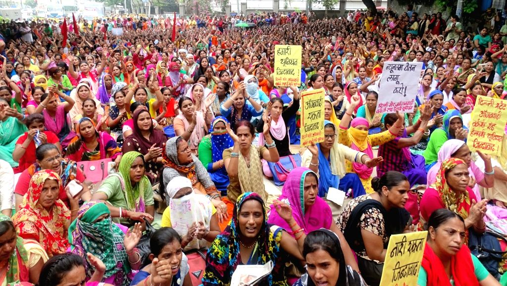 Anganwadi workers stage a demonstration outside Delhi Chief Minister Arvind Kejriwal's residence to press for their demands on July 3, 2017. - Arvind Kejriwal