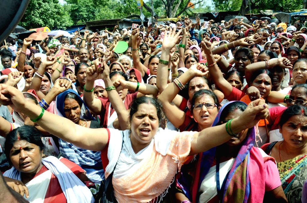 Anganwadi workers stage a demonstration to press for their demands in Patna, on Aug 12, 2015.