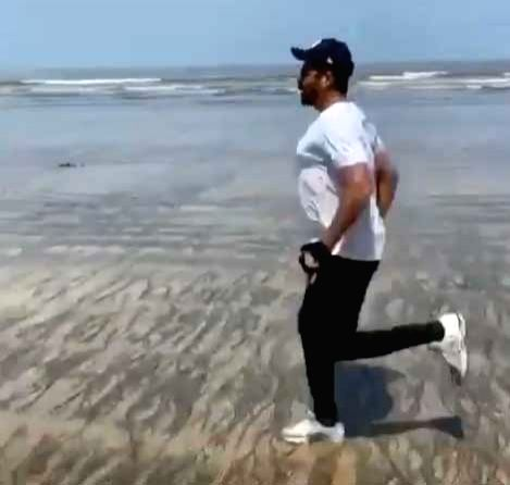 Anil Kapoor turns beach into workout spot. - Kapoor
