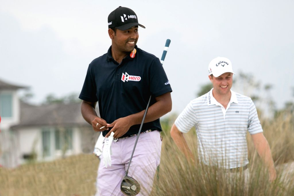 Anirban Lahiri tees-off with Chris Kirk on day two of the 2015 Hero World Challenge in Albany, Bahamas.