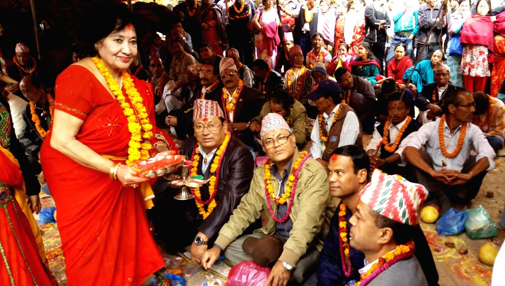 Anjali Maskey (L), a Nepalese female socialist, performs a group celebration during Bhai Tika, the fifth and last day of Tihar festival, at Ranipokhari in ...