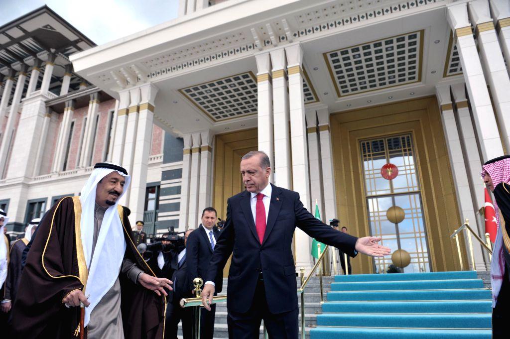 ANKARA, April 12, 2016 - Turkish President Recep Tayyip Erdogan (R) welcomes visiting King of Saudi Arabia Salman bin Abdulaziz al Saud (L) in the presidential palace in Ankara, Turkey, April 12, ...