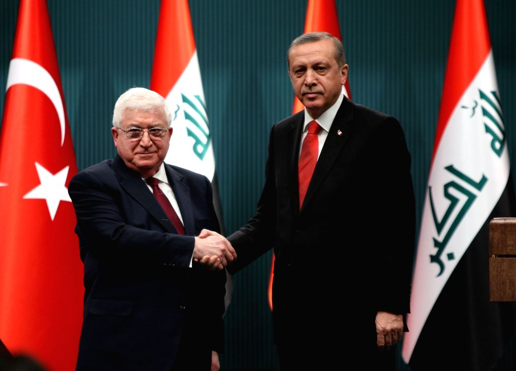 Turkish President Recep Tayyip Erdogan (R) shakes hands with his visiting Iraqi counterpart Fuad Masum during a joint press conference in Ankara, Turkey, on April ...