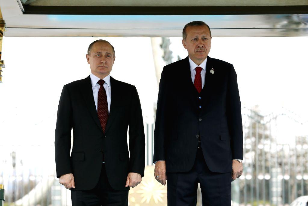 ANKARA, April 3, 2018 - Turkish President Recep Tayyip Erdogan (R) welcomes Russian President Vladimir Putin at the Presidential Palace in Ankara, Turkey, on April 3, 2018.