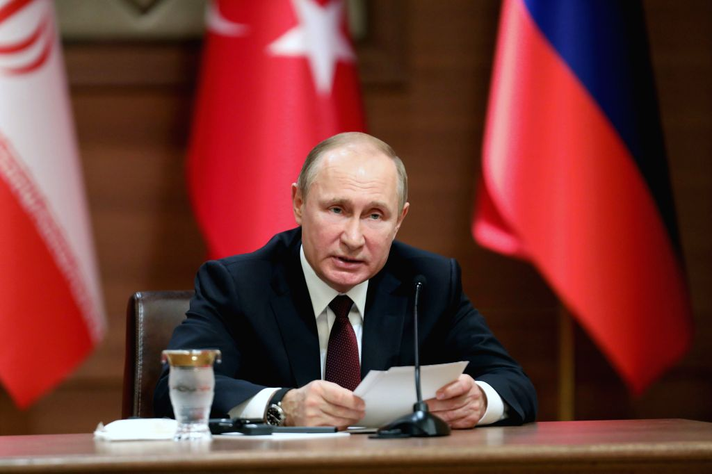 ANKARA, April 4, 2018 - Russian President Vladimir Putin speaks during a joint press conference with his Turkish and Iranian counterparts after their meeting on Syria issues at the Presidential ...
