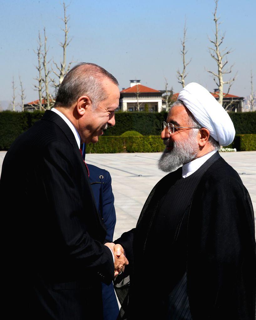 ANKARA, April 4, 2018 - Turkish President Recep Tayyip Erdogan (L) shakes hands with Iranian President Hassan Rouhani at the Presidential Palace in Ankara, Turkey, on April 4, 2018. - Hassan Rouhani