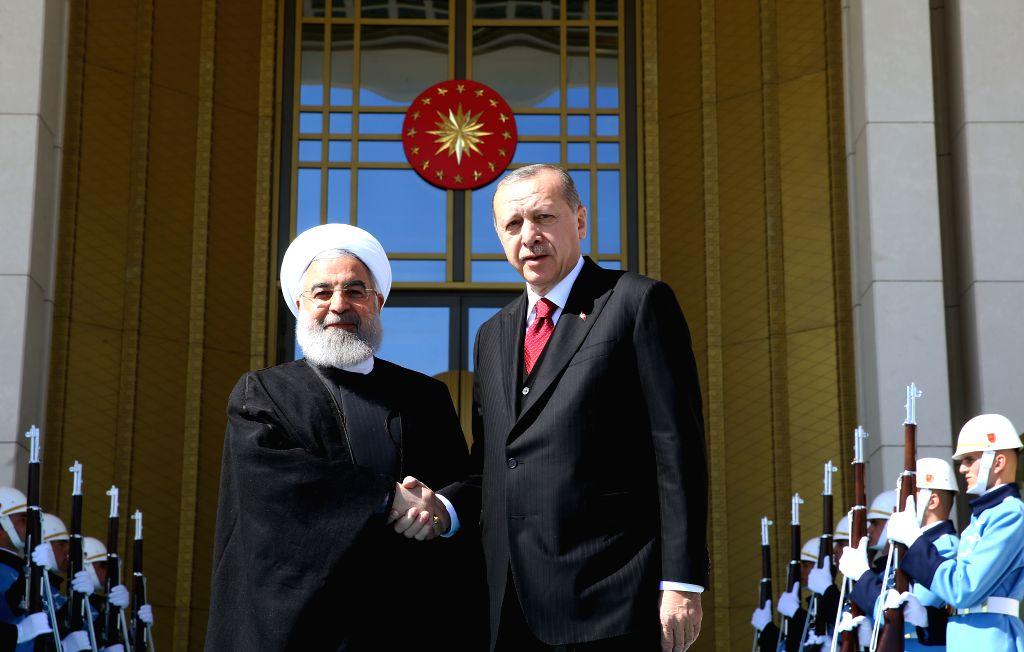 ANKARA, April 4, 2018 - Turkish President Recep Tayyip Erdogan (R) welcomes Iranian President Hassan Rouhani at the Presidential Palace in Ankara, Turkey, on April 4, 2018. - Hassan Rouhani