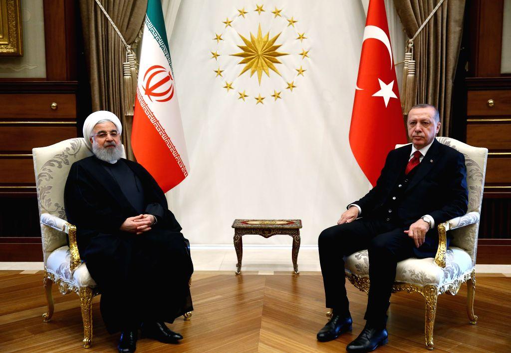 ANKARA, April 4, 2018 - Turkish President Recep Tayyip Erdogan (R) speaks with Iranian President Hassan Rouhani at the Presidential Palace in Ankara, Turkey, on April 4, 2018. - Hassan Rouhani