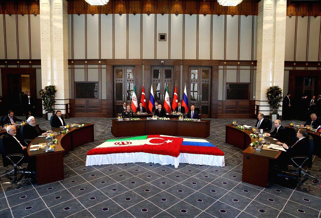 ANKARA, April 4, 2018 - Turkish President Recep Tayyip Erdogan, Russian President Vladimir Putin and Iranian President Hassan Rouhani meet on Syria issues at the Presidential Palace in Ankara, ... - Hassan Rouhani