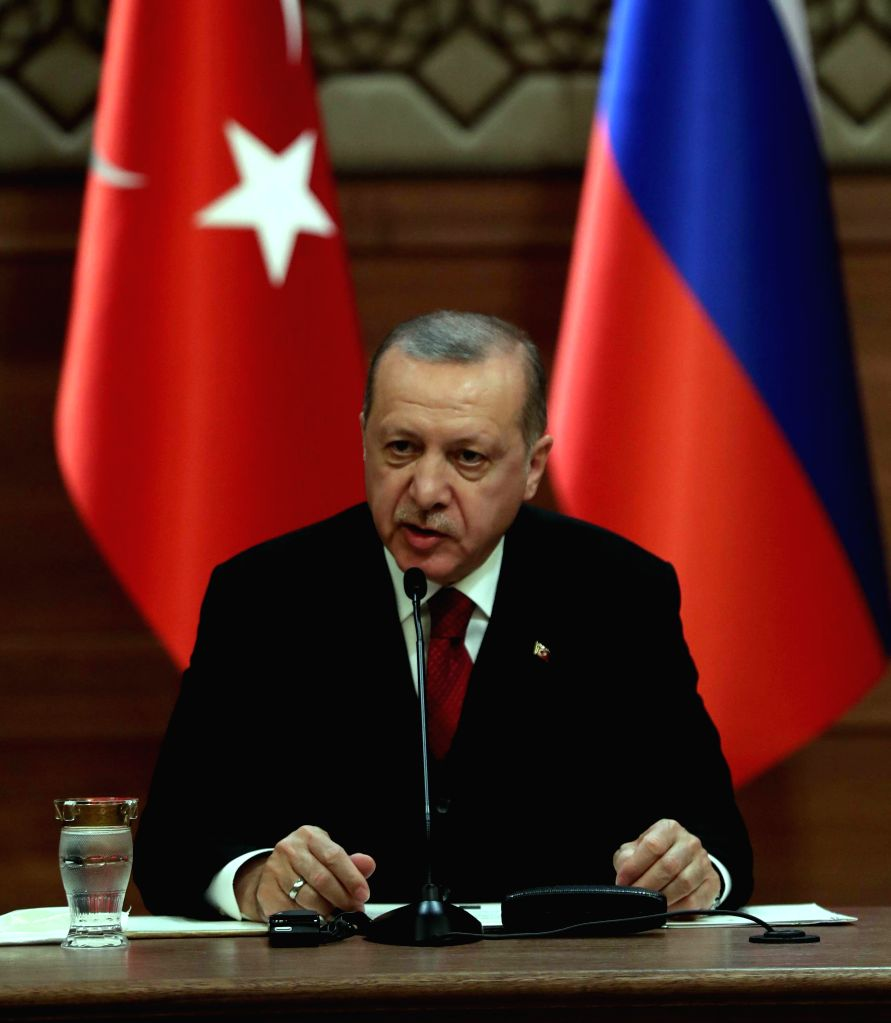 ANKARA, April 4, 2018 - Turkish President Recep Tayyip Erdogan speaks during a joint press conference with his Russian and Iranian counterparts after their meeting on Syria issues at the Presidential ...
