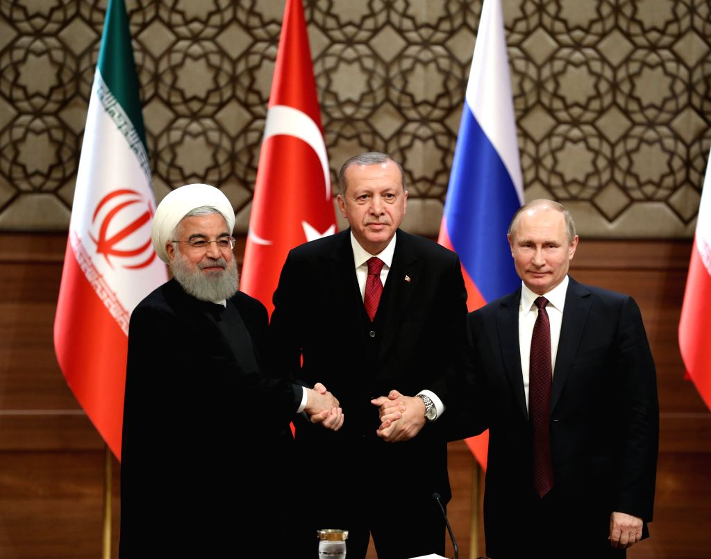ANKARA, April 4, 2018 - Turkish President Recep Tayyip Erdogan (C), Russian President Vladimir Putin (R) and Iranian President Hassan Rouhani attend a joint press conference after their meeting in ... - Hassan Rouhani