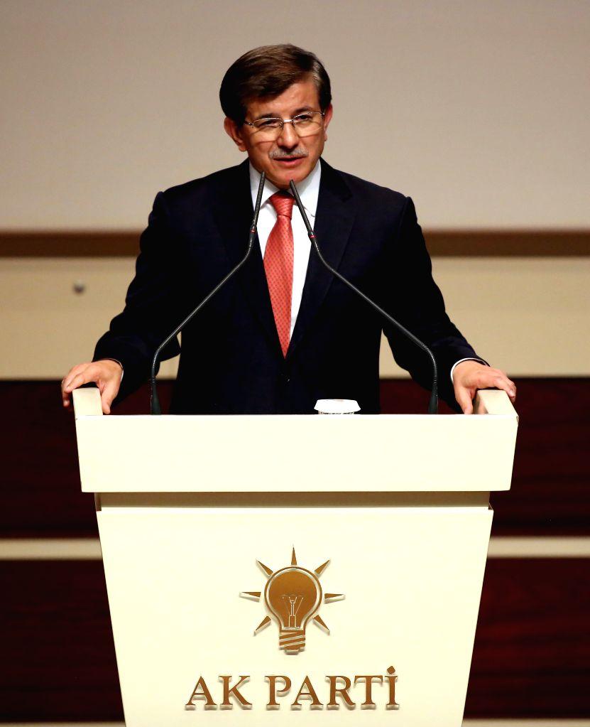 Turkey's Foreign Minister Ahmet Davuroglu delivers a speech in Ankara, Turkey, on Aug. 21, 2014. Turkey's president-elect Recep Tayyip Erdogan announced on Thursday .