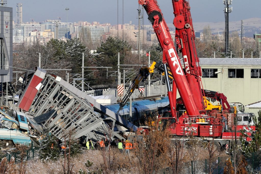 ANKARA, Dec. 13, 2018 - Rescue machines work at the site of a train accident in Ankara, Turkey, on Dec. 13, 2018. A Turkish high-speed train collided with a locomotive and crashed into a pedestrian ...
