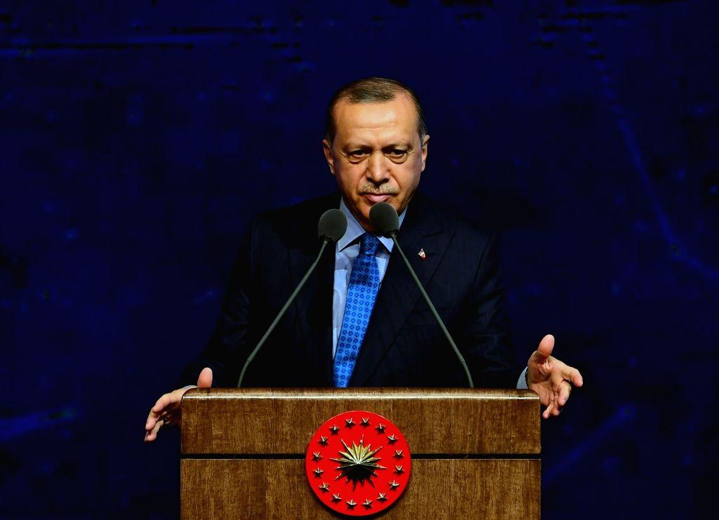 ANKARA, Dec. 13, 2018 - Turkish President Recep Tayyip Erdogan delivers a speech during the Turkish Defense Industry Summit in Ankara, Turkey, on Dec. 12, 2018. Turkey will launch a military ...