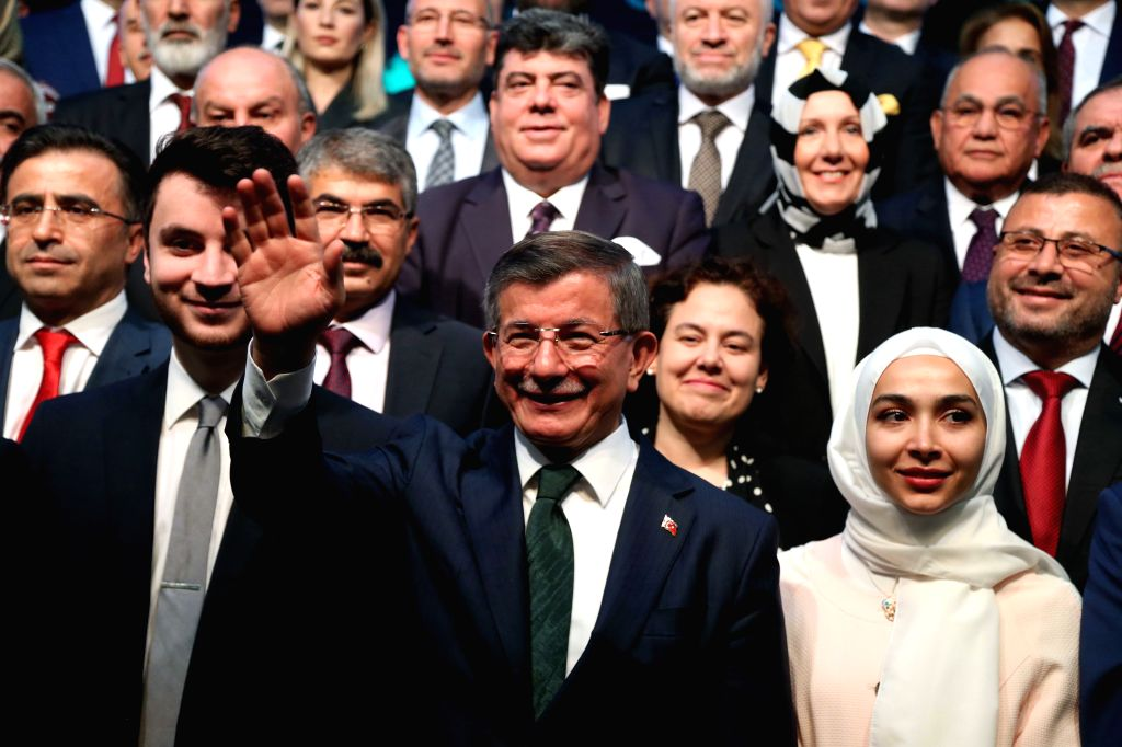 ANKARA, Dec. 13, 2019 - Turkey's former Prime Minister and Chairman of the ruling Justice and Development Party (AKP) Ahmet Davutoglu (C, Front) attends the launch ceremony of Future Party in Ankara, ...